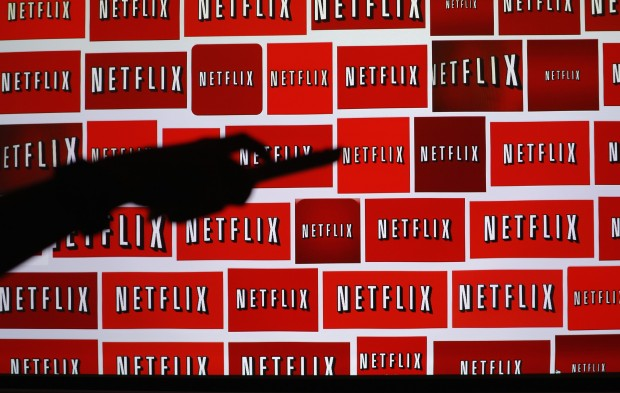 The Netflix logo is shown in this file illustration photograph in Encinitas, California